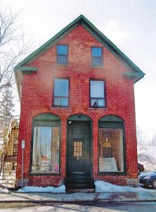 The renter of this historic building on Main Street in Alexandria, with permission from the property owner, applied for funding under North Glengarry's CIP for renovations including replacing a rotted window frame and installing antique doors. (Photo: North Glengarry council document)