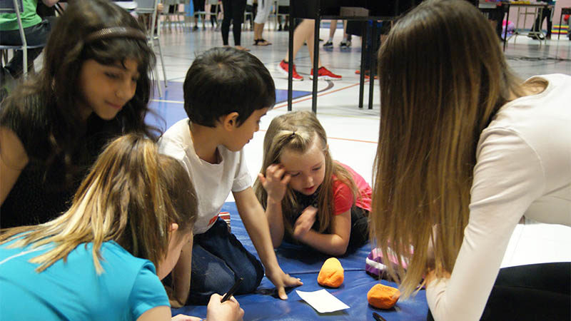 Seven and eighth-graders helped younger students decorate their rocks.