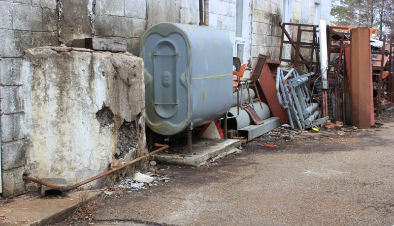 Some of the outside storage including an old oil tank right next to the Frappiers' residence.