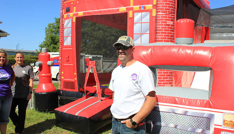 Eric St-Jean of Magic Bounce, a Hawkesbury-based inflatable game rental, offered a firefighter theme bouncy house for the kids.