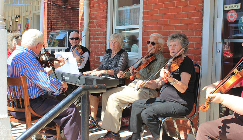 Fiddlers played tunes for passer-bys.