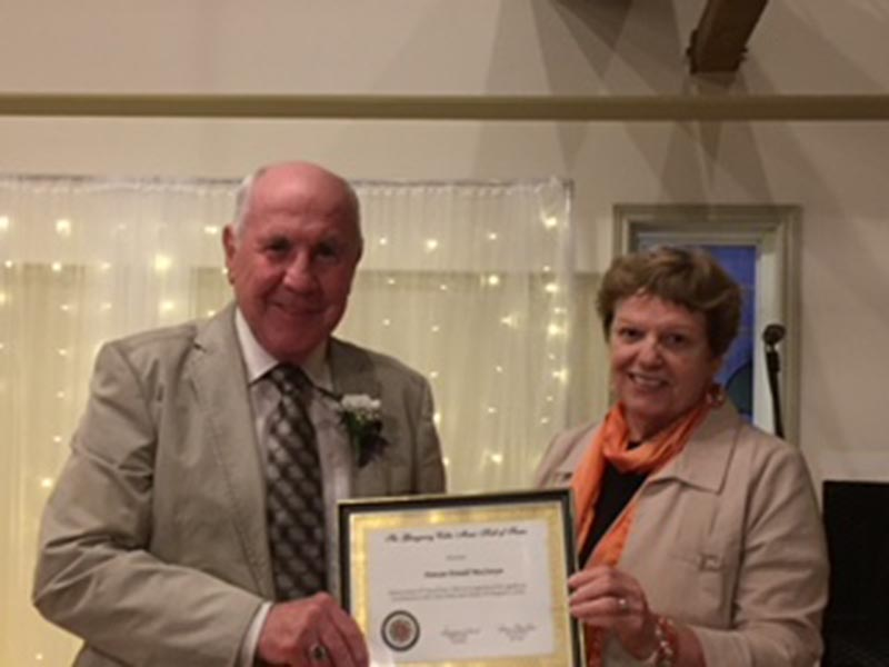 Duncan Donald MacSweyn accepting his award for a lifetime of promoting Celtic music