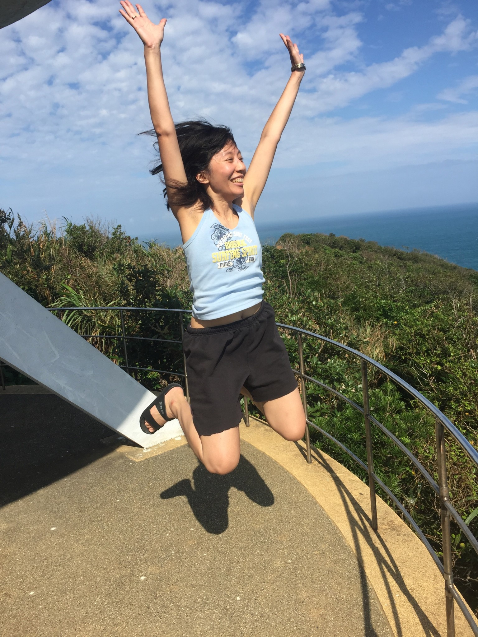 Captions: Author Dr  Melissa Yuan-Innes jumps for joy in Taiwan