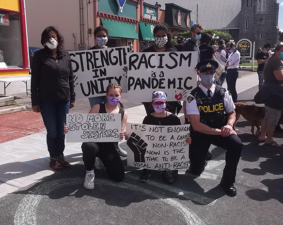 SUBMITTED JUNE 17 2020 PHOTO OF BLACK LIVES MATTER ORGANIZERS WITH POLICE OFFICER