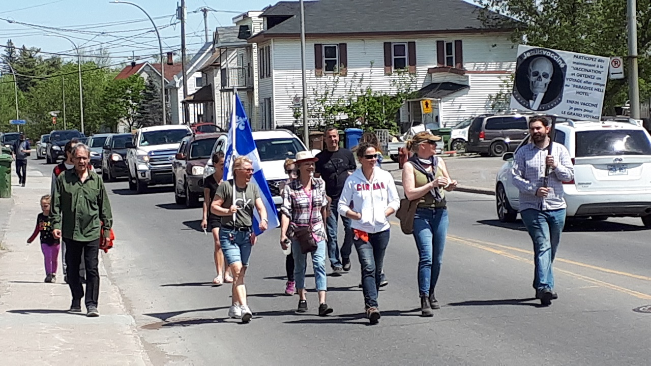 Small protest against COVID-19 vaccine and restrictions takes to the streets of Lachute - The Review Newspaper